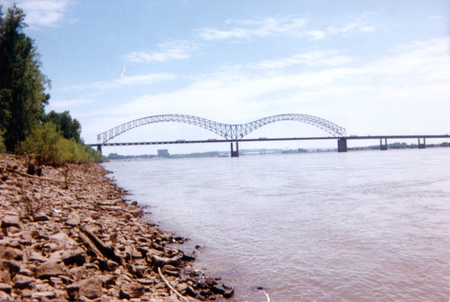 A shot of the I-40 bridge crossing the Mississippi River. This photo sucks because I used a disposable camera. After the film was developed, I dropped the photos (and my Newton 120 PDA) off the bike on I-96 east of Grand Rapids, MI. Several cars/trucks ran over the photos (and my Newton) before I could retrieve them. Instead of scanning the negatives to a Photo-CD, I scanned the abused photos on a flatbed scanner at a local Kinkos Copies. Again, this is why this photo sucks.