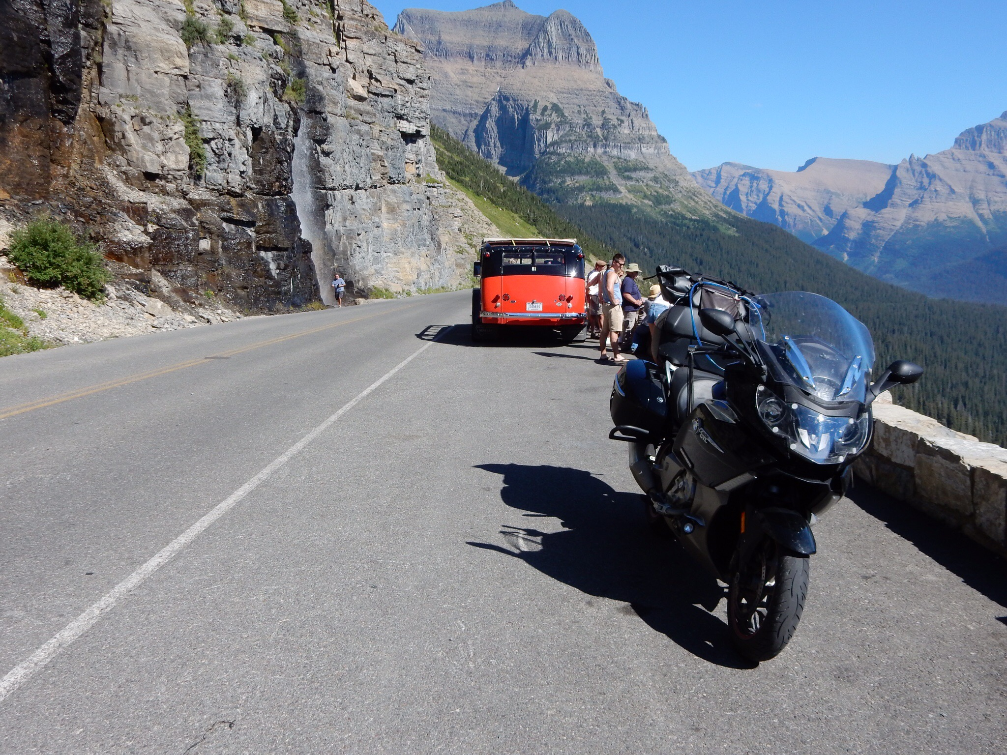 The Nightowl and a classic tour bus on the Going-to-the-Sun Road.