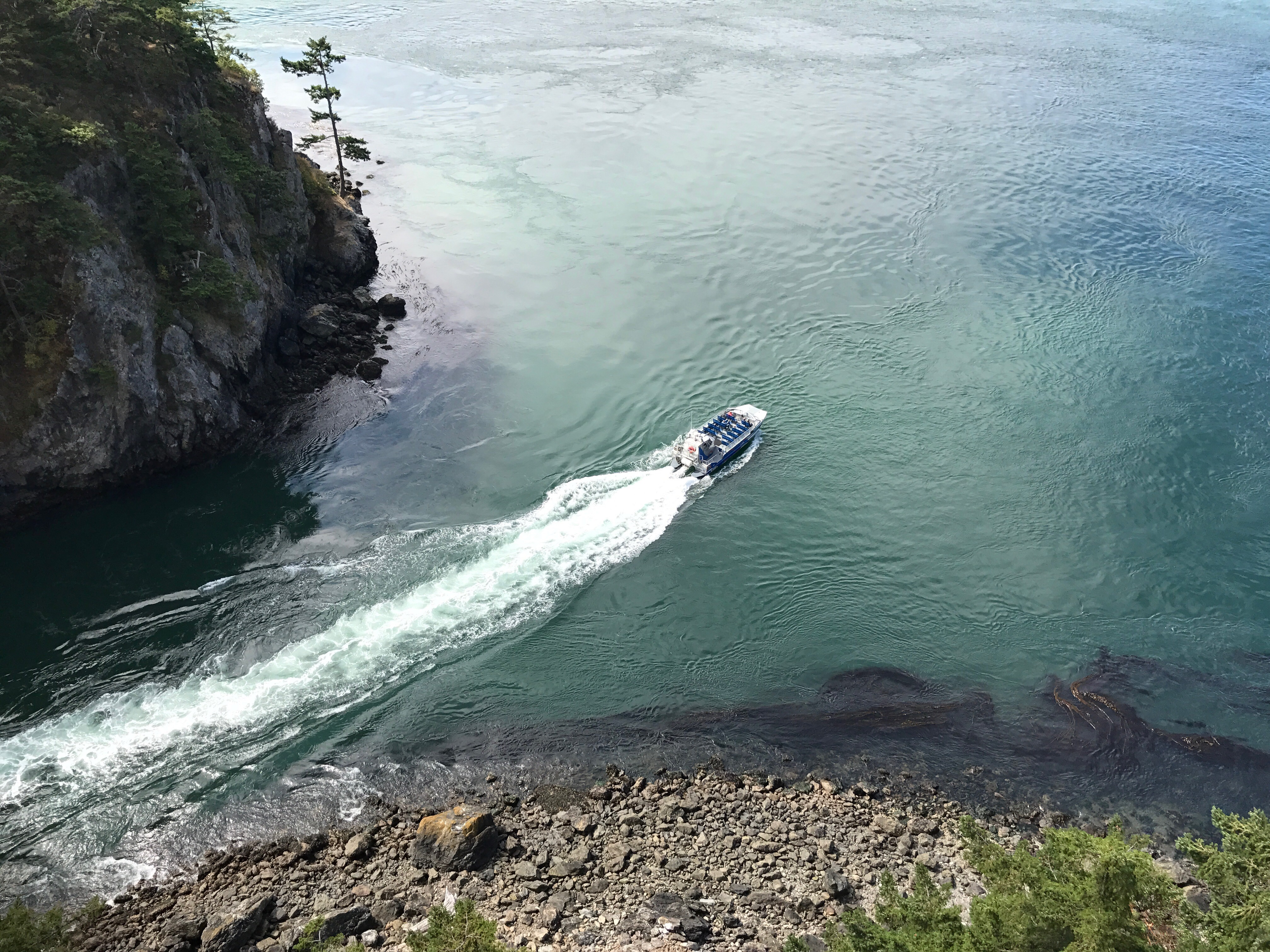 A tour boat navigates through Deception Pass.A tour boat navigates through Deception Pass.
