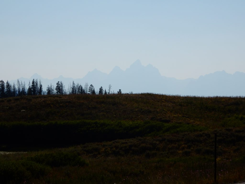 The afternoon haze leaves only a scant outline of the Tetons as I cross Togwotee Pass eastbound.