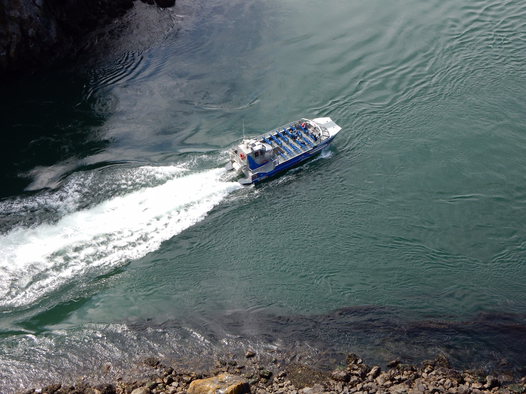 A tour boat navigating Deception Pass.A tour boat navigating Deception Pass.