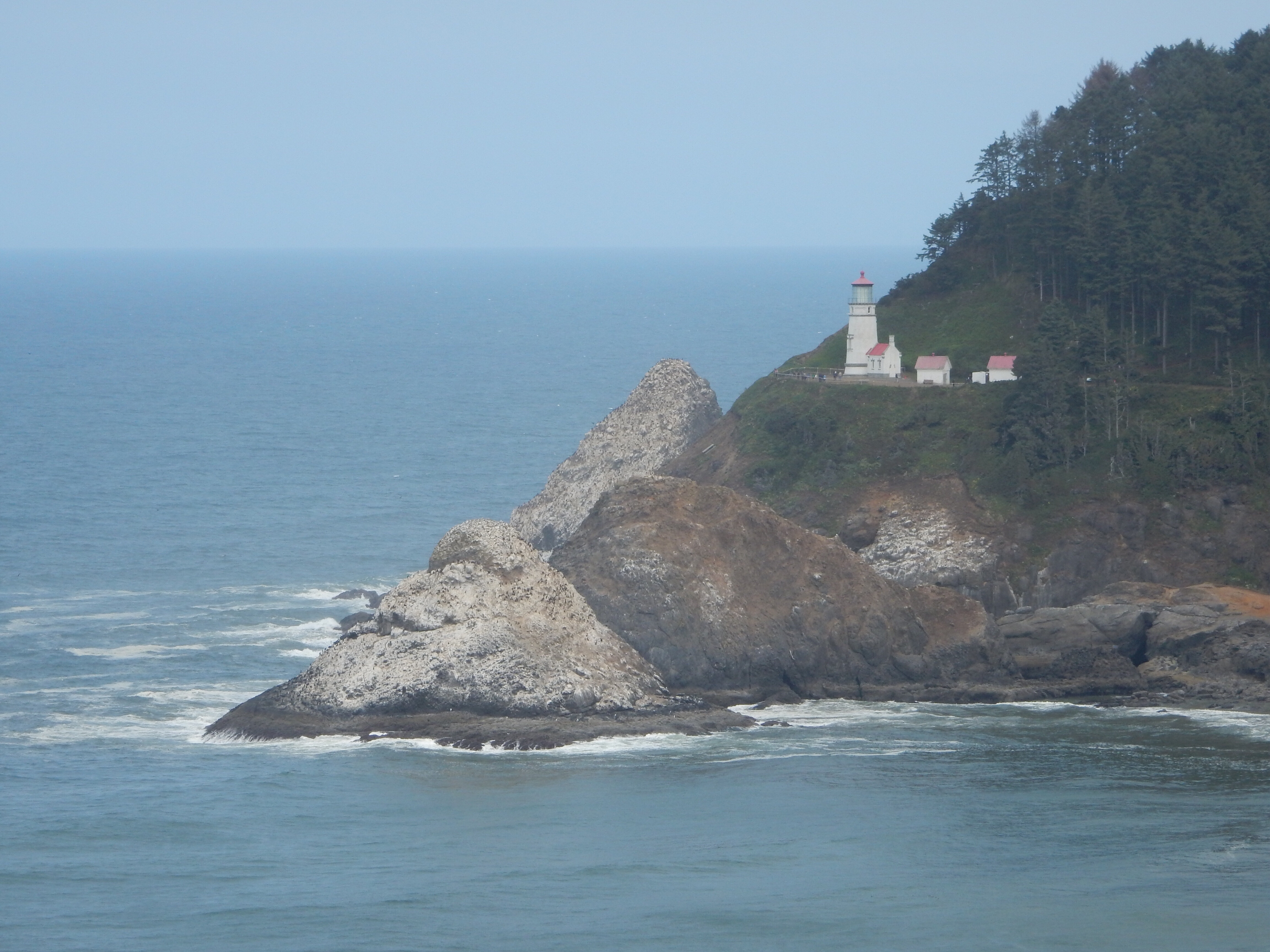 A distant look at the Heceta Head lighthouse.