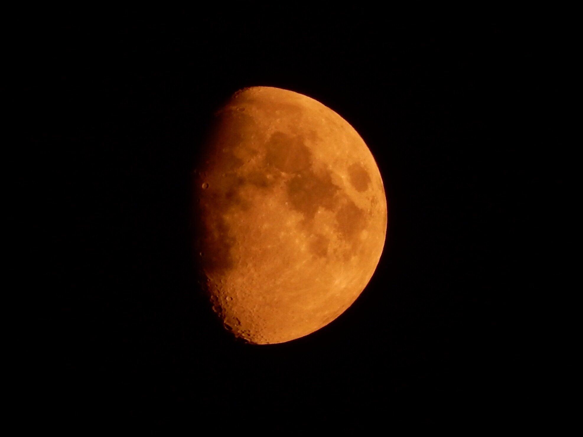 Red moons are usually photographed close to the horizon where the man-made particulates in the air make the moon show red. This moon, however, is high in the sky. The red comes from all the smoke in the air from all the wildfires burning in British Columbia.