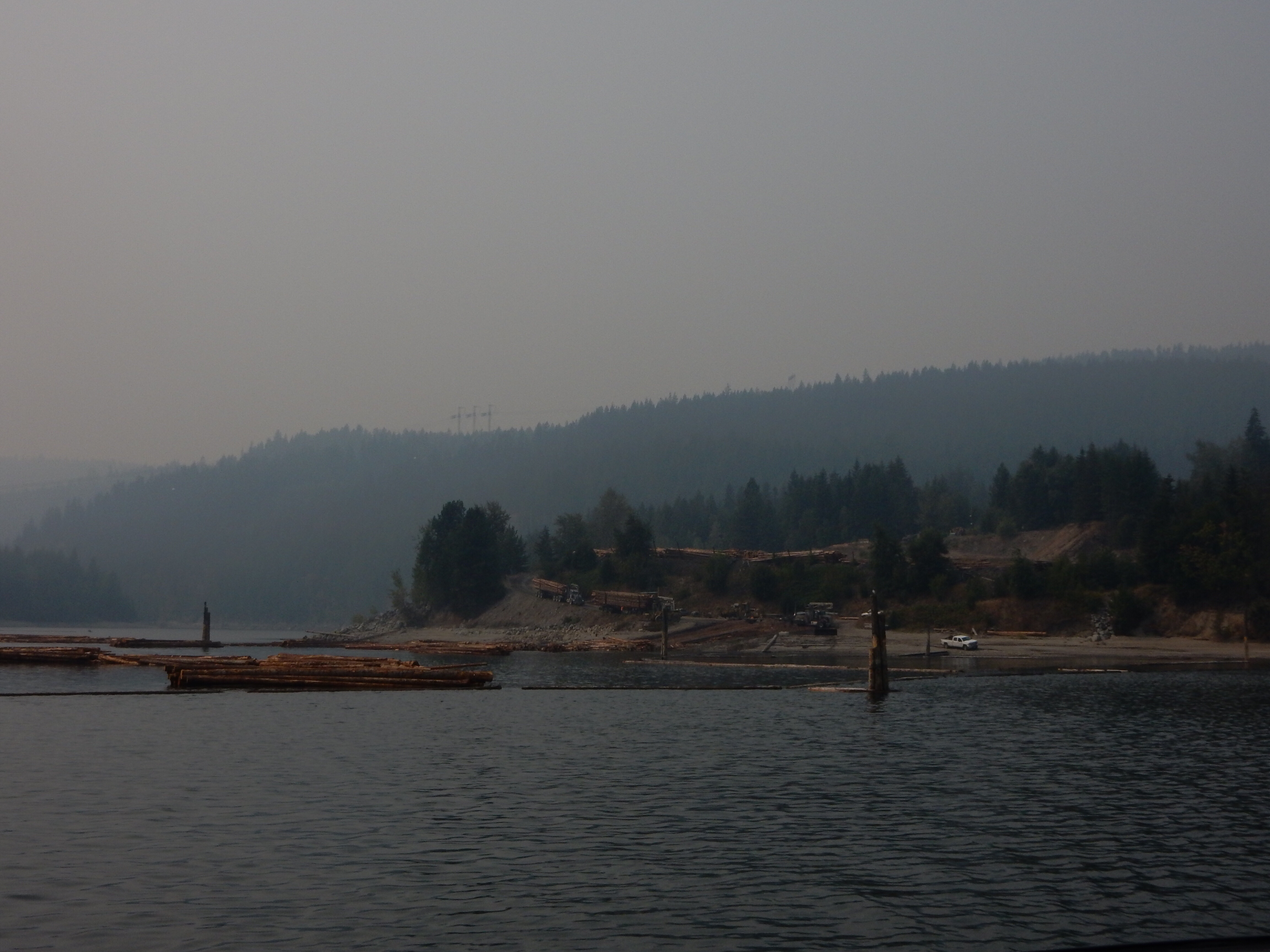 A float logging operation on the west bank of Arrow Lake, as seen from the Needles ferry.